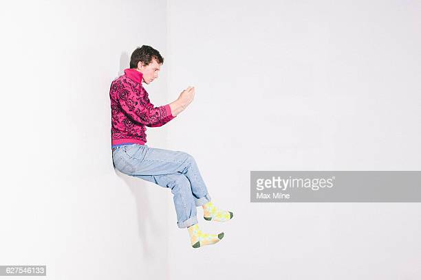 Caucasian man using cell phone in mid