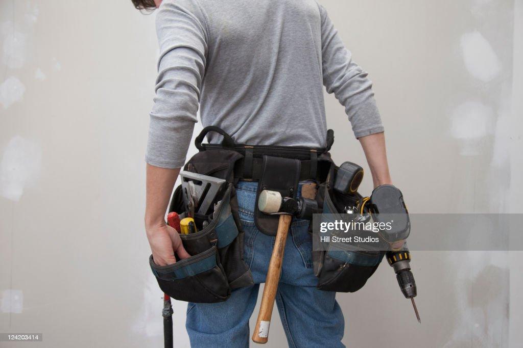 Caucasian man wearing tool belt : Stock Photo
