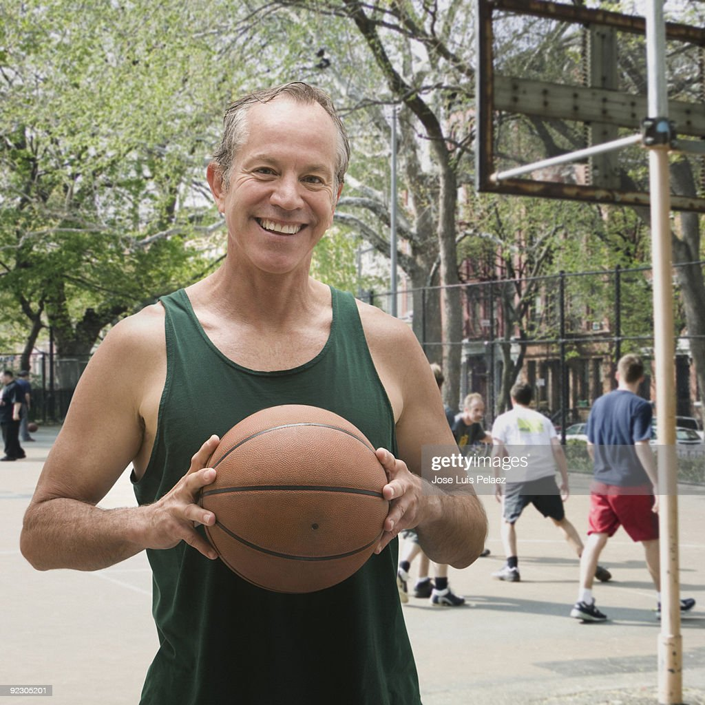 Caucasian man with basketball : Stock Photo
