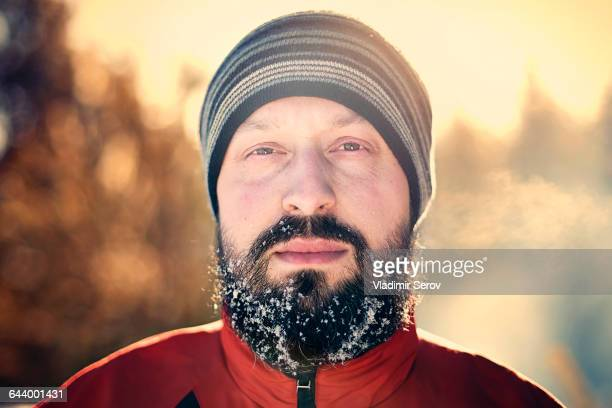 Caucasian man with snow in beard