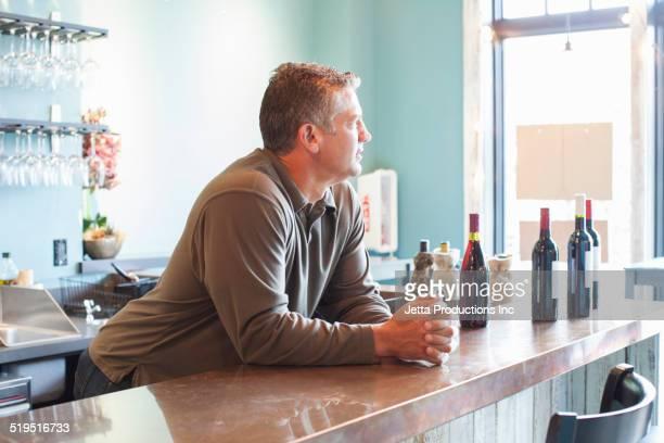 Caucasian man working at bar