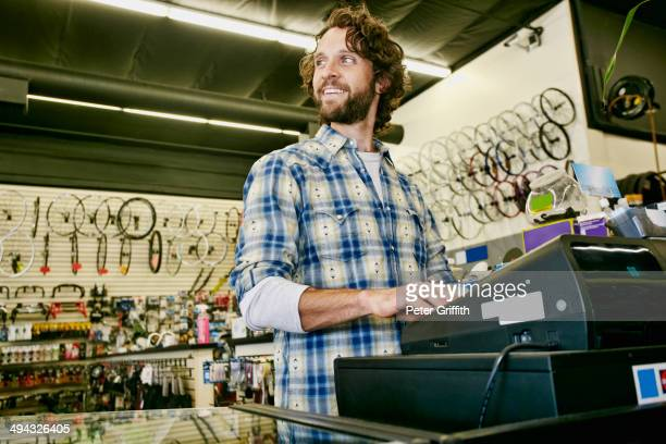 Caucasian man working in bicycle shop