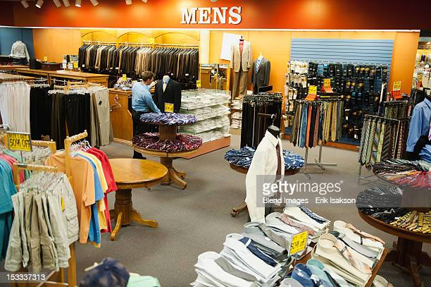 Caucasian man working in men's clothing store