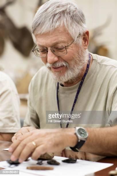 Caucasian man working in natural history museum