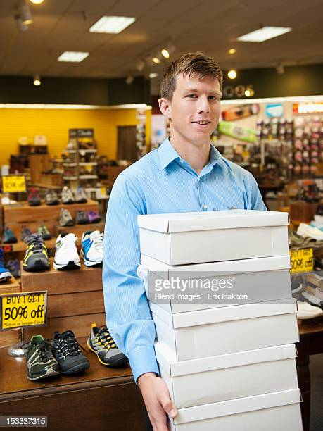 Caucasian man working in shoe store