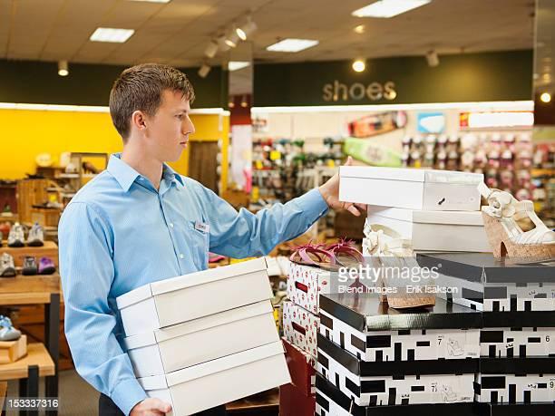 Caucasian man working in shoe store