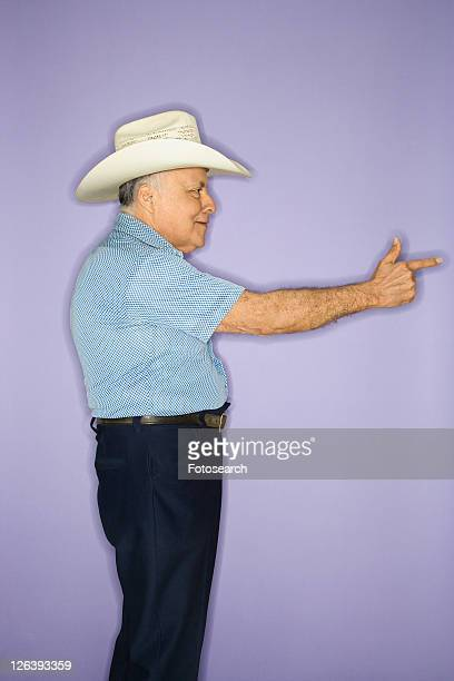 Caucasian mature adult male wearing cowboy hat.