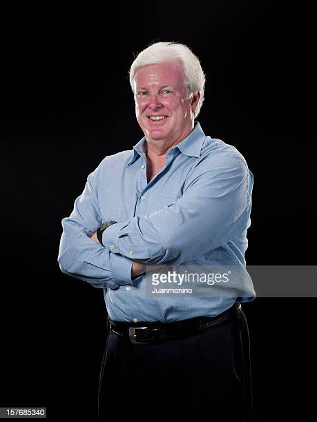 Caucasian Mature Man standing in front of black background