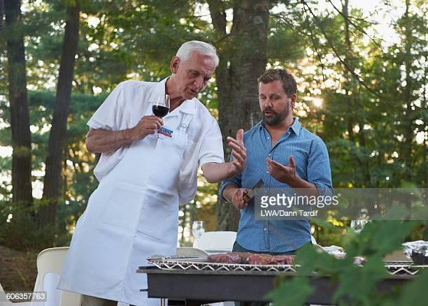 Caucasian men grilling at barbecue