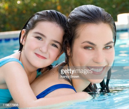 Caucasian mom and daughter in swimming pool stock photo for Chicken in swimming pool