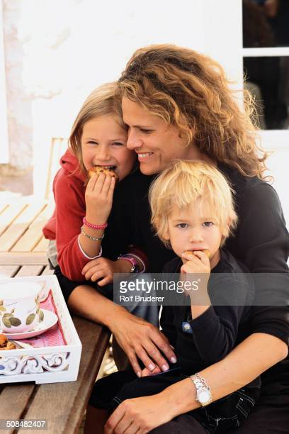 Caucasian mother and children eating outdoors
