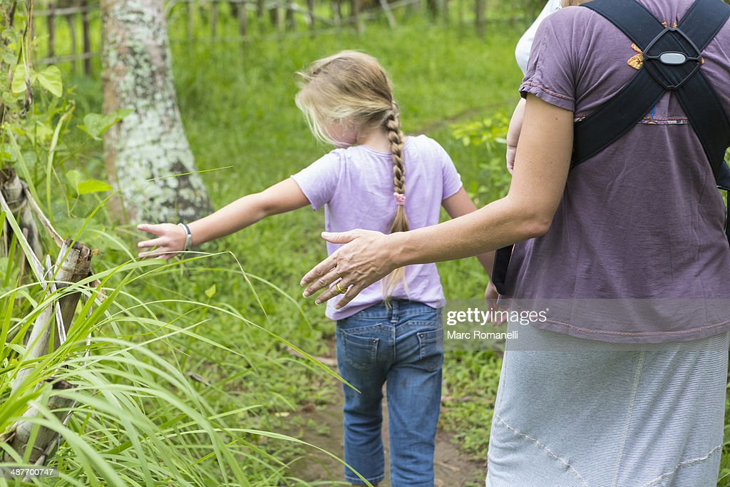 Caucasian mother and children walking in forest : Stock Photo