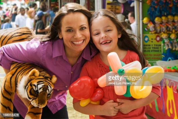 Caucasian mother and daughter enjoying the fair