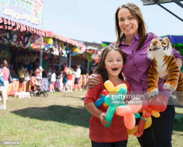 Caucasian mother and daughter enjoying the fair