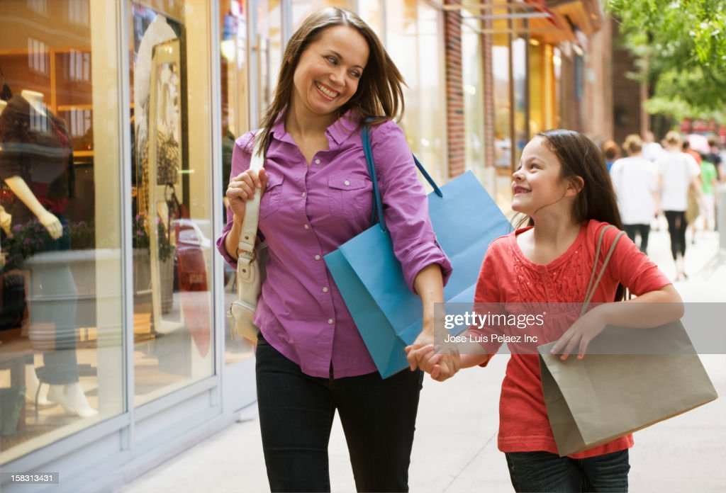 Caucasian mother and daughter shopping together : Stock Photo