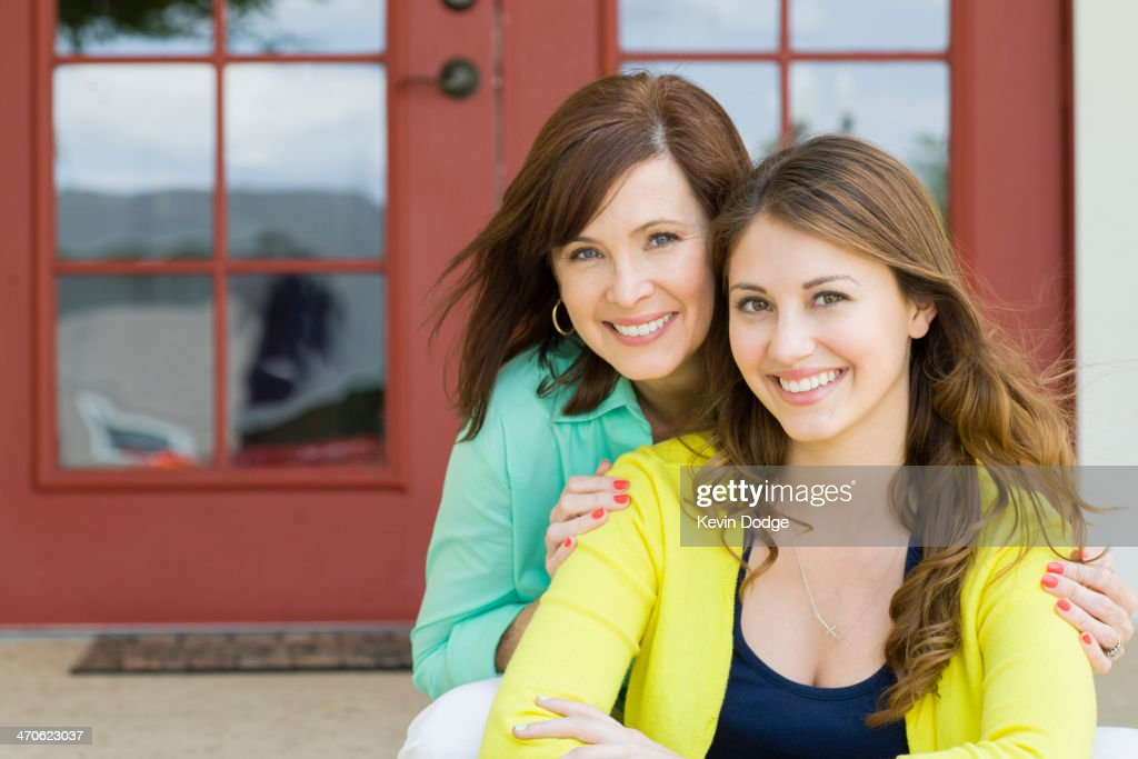 Caucasian mother and daughter smiling outdoors : Stock Photo