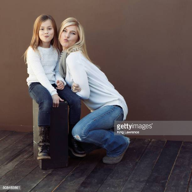 Caucasian mother and daughter smiling together