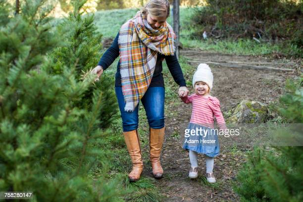 Caucasian mother and daughter walking on path