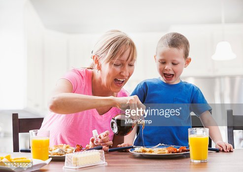 Caucasian mother and son having breakfast : Stock Photo