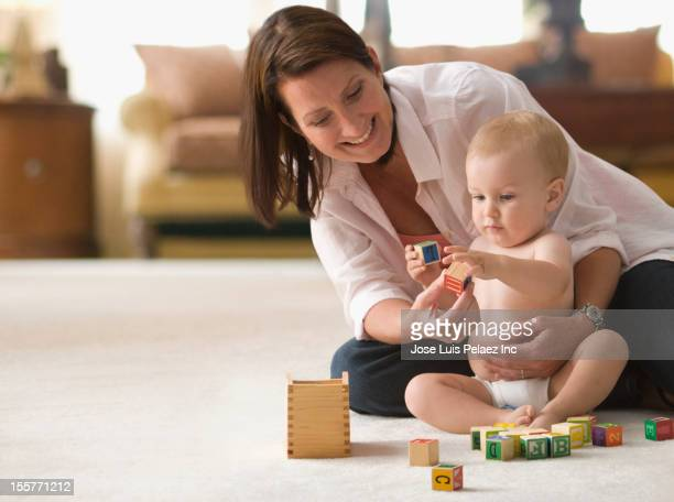 Caucasian mother and son playing with blocks