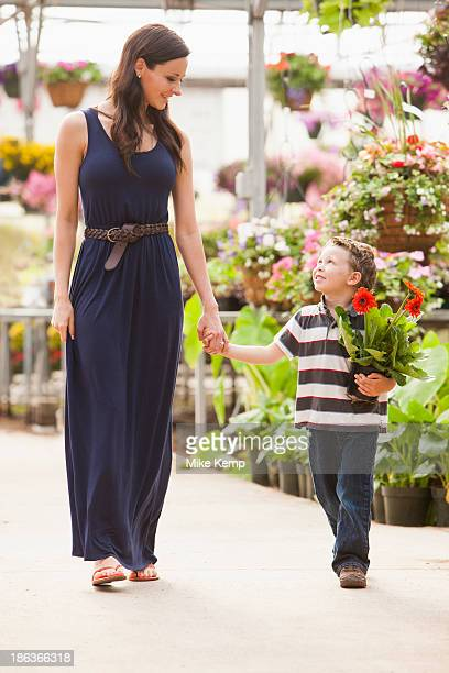 Caucasian mother and son shopping in nursery