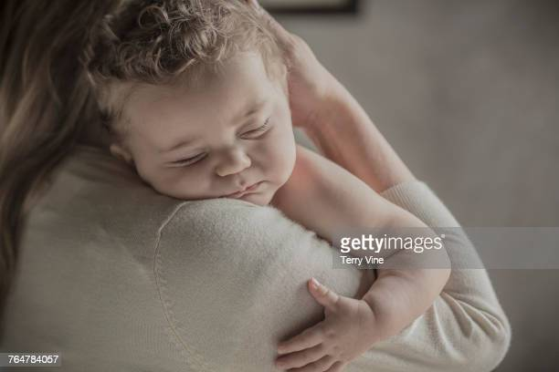 Caucasian mother holding baby boy