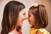 Caucasian mother smiling at daughter