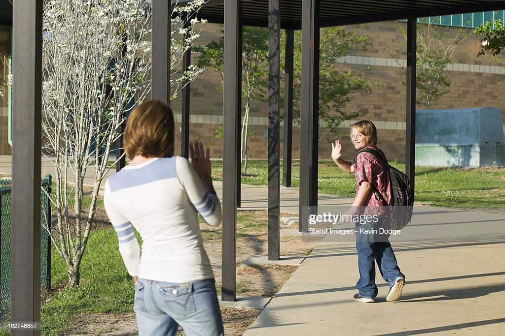Caucasian mother waving to son