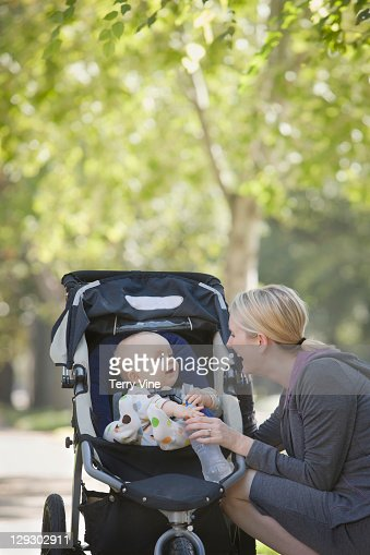 Caucasian mother with baby in stroller