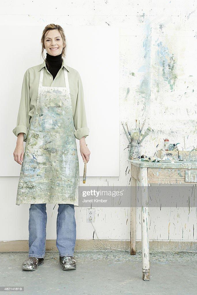 Caucasian painter smiling in studio