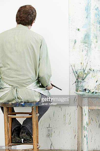 Caucasian painter working in studio