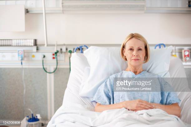 Caucasian patient laying in hospital bed