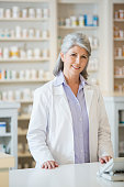 Caucasian pharmacist standing at counter
