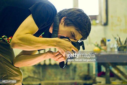 Caucasian photographer working in studio