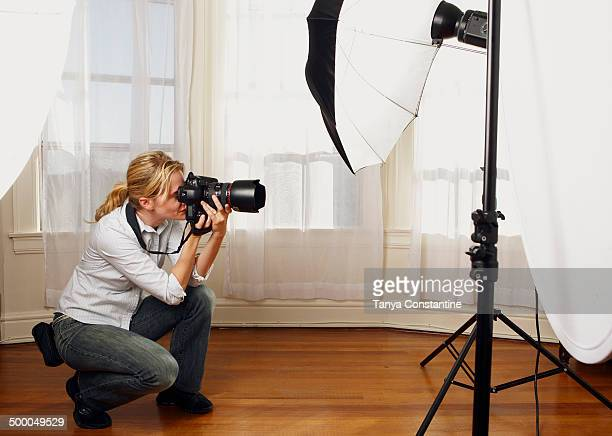 Caucasian photographer working in studio