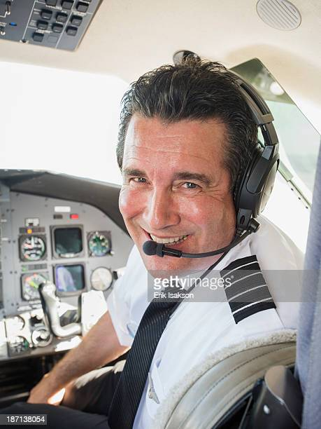 Caucasian pilot in airplane cockpit