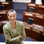 Caucasian politician smiling in chamber