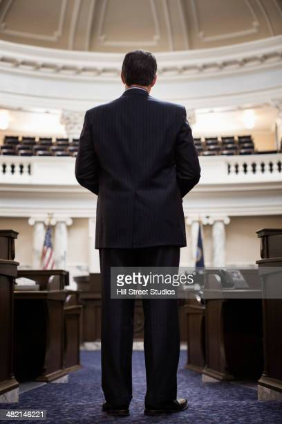 Caucasian politician standing in government building
