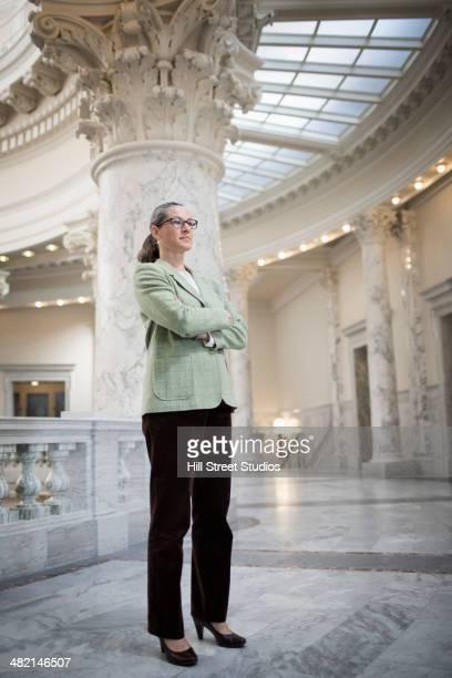 Caucasian politician standing in government building