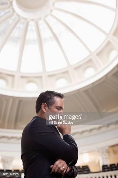 Caucasian politician thinking in government building