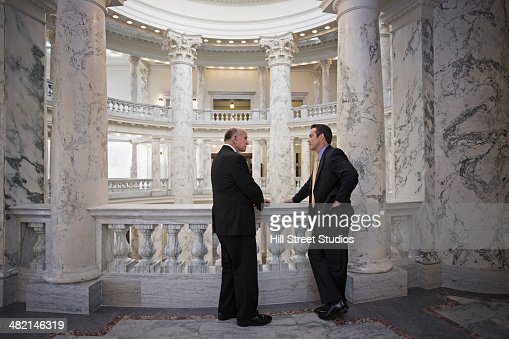 Caucasian politicians talking in government building