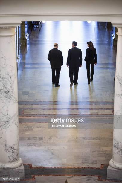 Caucasian politicians talking in government building