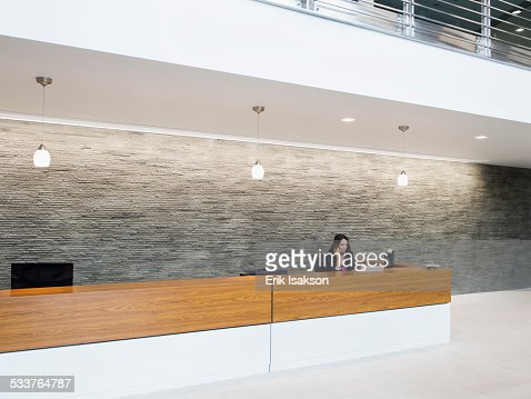 Caucasian receptionist working at office front desk