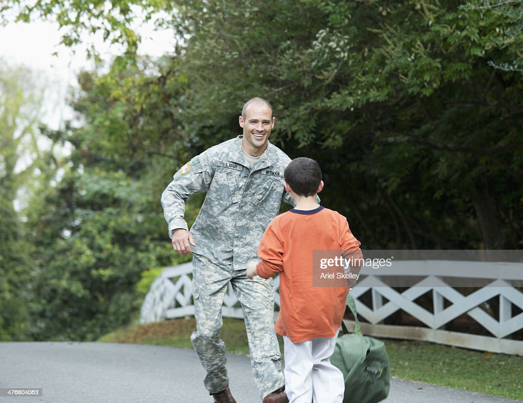 Caucasian returning soldier greeting son