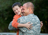 Caucasian returning soldier greeting son
