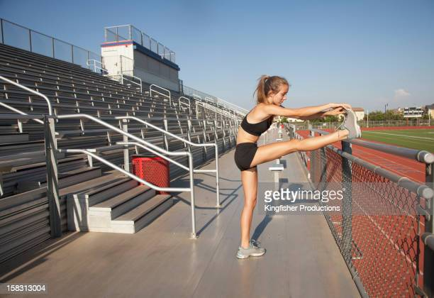 Caucasian runner stretching before exercise