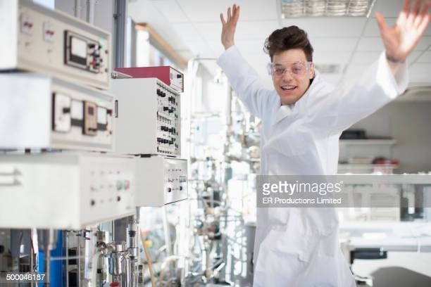 Caucasian scientist dancing in lab