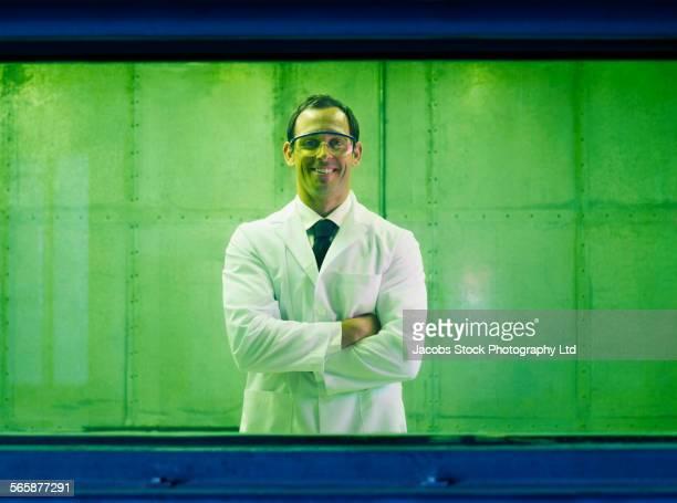 Caucasian scientist smiling in industrial lab