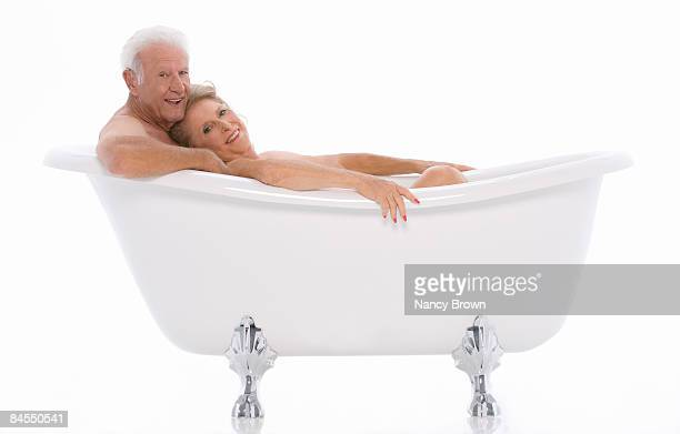 Caucasian Senior couple in Bathtub