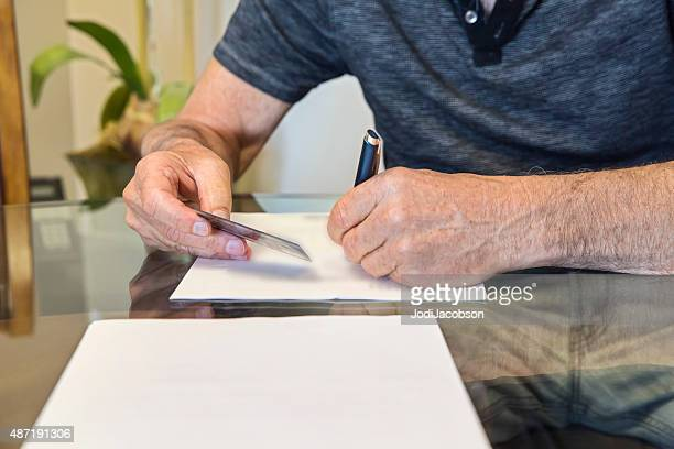 Caucasian senior man at signing of mortgage agreement